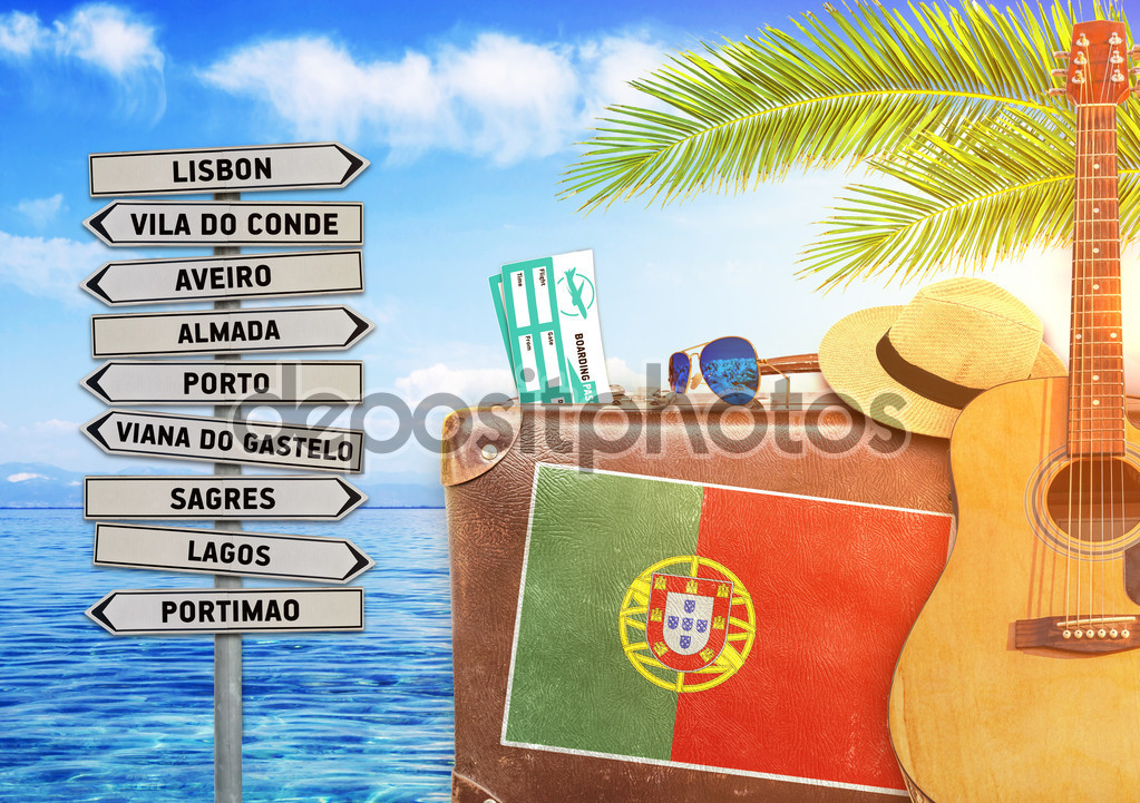Concept of summer traveling with old suitcase and Portugal with
